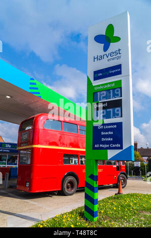 1949 AEC Regent lll double-decker shuttle bus of the Epping Ongar Railway refuelling at a Harvest Energy petrol station, North Weald, Essex, England - Stock Image