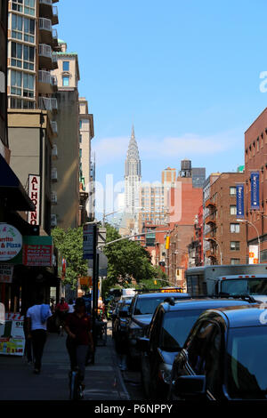 NEW YORK, NY - JUNE 22: View North Lexington Avenue with Chrysler Building in the distance, Gramercy, Manhattan on JUNE 22nd, 2017 in New York, USA. ( - Stock Image