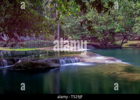 Beautiful waterfall in Thailand, near the Namtok Chet Sao Noi Park, Saraburi, featuring lush green tropical vegetation, long exposure - Stock Image
