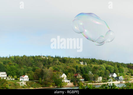Soap bubble floating in the misty sky near Bar Harbor, Maine. - Stock Image