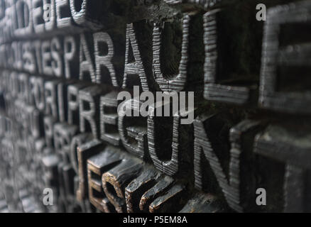 Old wooden carved detailed relief lettering, Barcelona, Italy. - Stock Image