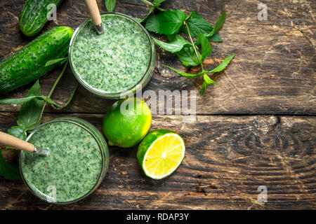 Fresh green smoothie . On a wooden background. - Stock Image