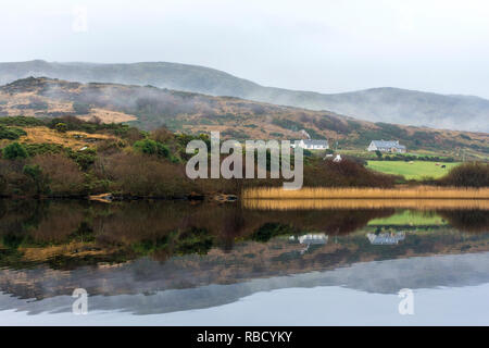 Ardara, County Donegal, Ireland. 9th January 2019. Tranquil reflections in Lake Shanaghan on a still misty morning. Credit: Richard Wayman/Alamy Live News - Stock Image