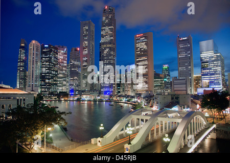 Singapore skyline, Elgin Bridge, and Boat Quay during dusk, Singapore - Stock Image