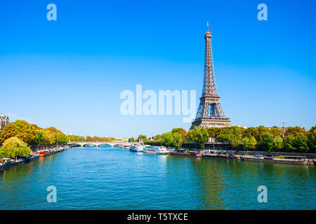 Eiffel Tower or Tour Eiffel is a wrought iron lattice tower on the Champ de Mars in Paris, France - Stock Image