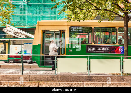 20 September 2018: Helsinki, Finland - Woman getting on a tram in the central city. - Stock Image