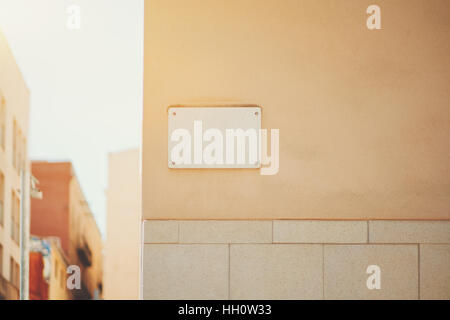 Marble house nameplate mock up on the corner of building in Barcelona, empty white space for number and text with - Stock Image