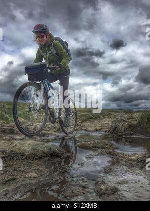 Extreme biking on Hardangervidda, Norway - Stock Image
