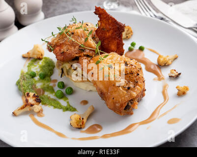 Crispy Fried Chicken with Cauliflower - Stock Image