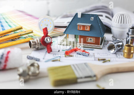 house building and repair concept - construction and design items on housing plan - Stock Image