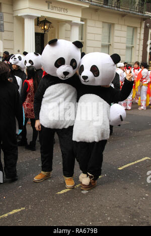 London, UK - January 2019 : About 8,000 performers representing the London boroughs and over 20 countries from across the globe take part on the annual New Years Parade on the street of London on January 1, 2019. The parade will as is custom include dancers, acrobats, cheerleaders, marching bands, historic vehicles and huge balloons making their way from Green Park Tube station to Parliament Square. Photo credit:  David Mbiyu/Alamy New Live - Stock Image
