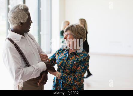 Active senior couple dancing in dance class - Stock Image