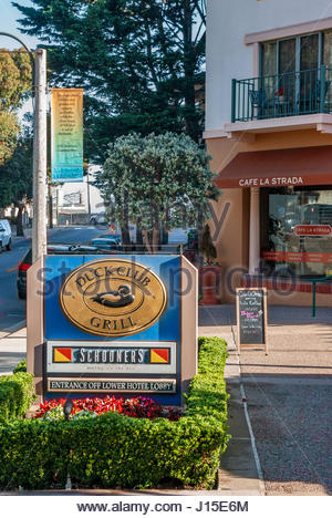 Signs advertise the Duck Club Grill, Schooners Bistro on the Bay and Café La Strada on Cannery Row in Monterey, - Stock Image