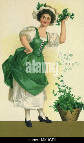 Woman Holding Clover - Stock Image