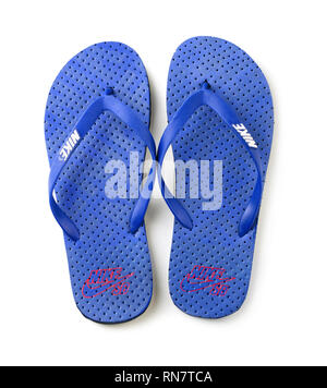 KRASNODAR, RUSSIA - July 7, 2018: Blue Nike flip flops isolated on a white background, showing the wite Nike logo and, illustrative editorial - Stock Image