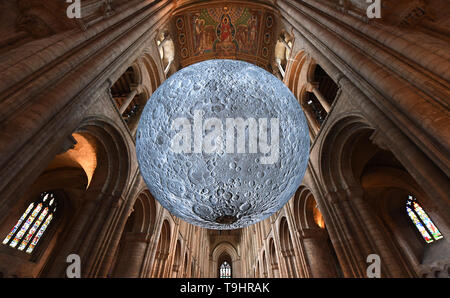 Luke Jerram's 'Museum of the Moon' installation at Ely Cathedral in Cambridgeshire. The 7 metre diameter replica of the moon is the star attraction at the cathedral's science festival, 'The Sky's The Limit', which celebrates the 50th anniversary of the first moon landing. - Stock Image