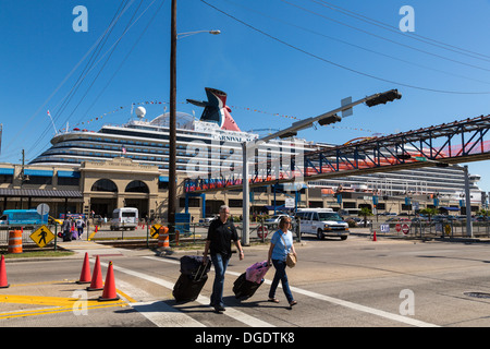 Passengers with luggage disembarking Carnival Magic cruise ship at Galveston Texas USA - Stock Image