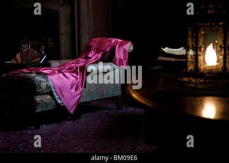 Close up of a red robe inside a bedroom - Stock Image
