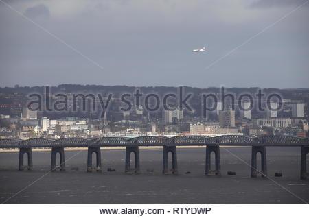 Loganair plane passing over Tay Rail Bridge Scotland  February 2019 - Stock Image