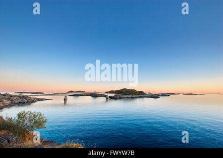 Sunset over the bridge leading to the fishing village Henningsvaer on Lofoten in northern Norway. - Stock Image