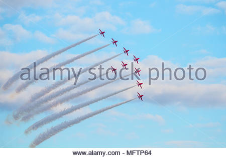 The Red Arrows performing team formation aerobatics at Duxford Battle of Britain 75th anniversary air show on 20 September 2015 in bright sunshine - Stock Image