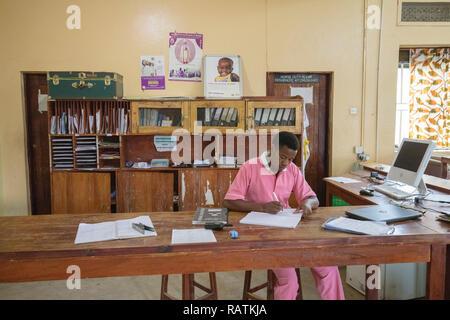 employee at desk, children's ward, Bwindi Community Hospital, Uganda, Africa - Stock Image