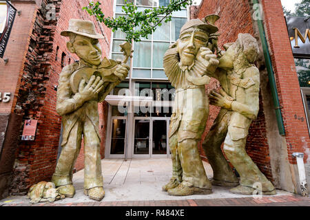The Liberty Avenue Musicians are three 15 foot concrete musicians in Pittsburgh, Pennsylvania's cultural and historic district by artist James Simon. - Stock Image