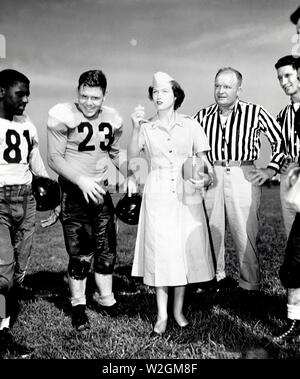 The Southwestern Command, Japan Logistical Command, Football Season Gets Underway with Pvt. Cecile Brothers of Hocombe, Missouri, a Member of the Camp Saki WAC Detachment, Flipping the Coin to See who Kicks Off ca. 9/13/1952 - Stock Image