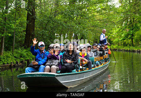 Tourists from China on a boat trip in a traditional Spreewald punt on the Spree river, Lehde near Luebbenau, Spreewald region, Germany - Stock Image