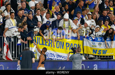 Optus Stadium, Burswood, Perth, W Australia. 17th July 2019. Manchester United versus Leeds United; pre-season tour; Kemar Roofe of Leeds United hands his match shirt to a Leeds supporter after the match ends Credit: Action Plus Sports Images/Alamy Live News - Stock Image