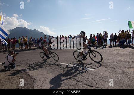 Chris Froome of Team Sky and Dan Martin of UAE Emirates cycling team competing climbing in France. 18th July, 2018. Tour de France 2018 cycling stage 11 La Rosiere Rhone Alpes Savoie France Credit: Fabrizio Malisan/Alamy Live News - Stock Image