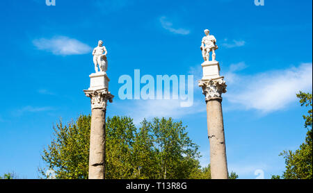Hercules and Julius Caesar statues on Roman columns in the Alameda in Seville - Stock Image