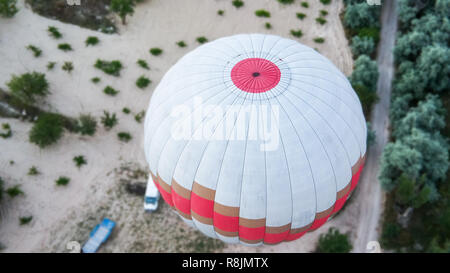 Aerial view of a hot-air balloon in Cappadocia, from above onto the balloon shortly after take-off. - Stock Image