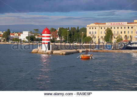 The boatman of Zadar, a family business of ferrying people in a row boat across the harbor. Going to get passenger - Stock Image