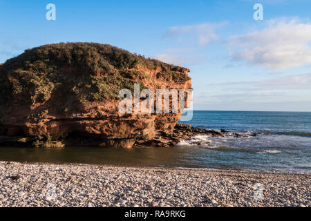 Otterton Ledge, at the mouth of the River Otter as it reaches the sea at Budleigh Salterton, Devon, UK. - Stock Image