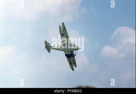 De Havilland Dragon Rapide Mark 3 G-AHGD biplane light aircraft at Shuttleworth Collection air show, Old Warden aerodrome, Bedfordshire, England, July 1982, crashed 1991 - Stock Image