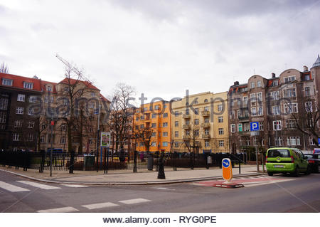 Poznan, Poland - March 8, 2019: Playground and apartment buildings by the Slowackiego street in the city center. - Stock Image