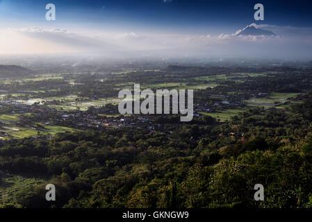 Aerial view of Yogyakarta with Merapi volcano from Bukit Bintang, Jawa, Indonesia - Stock Image