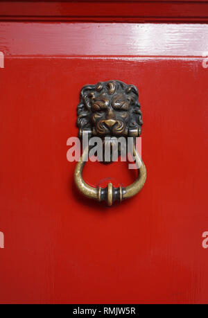 Red Door and Door Knocker. - Stock Image