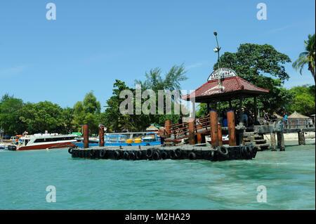 Floating dock jetty pier Gili Air Gili islands Lombok Indonesia - Stock Image