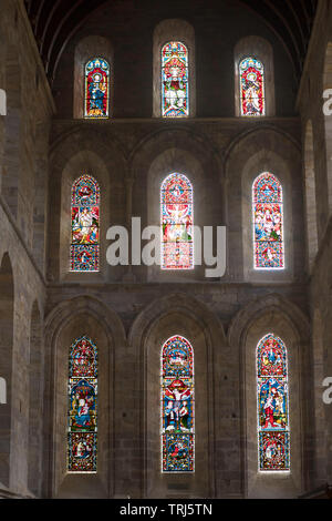 19th century east stained glass windows in  Brinkburn Priory church, Longframlington, Northumberland, England, UK - Stock Image