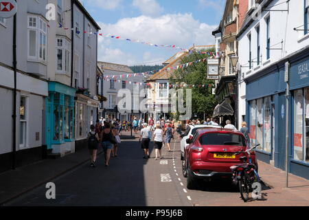 Shoppers walk down New Street in Sidmouth, Devon, UK - Stock Image