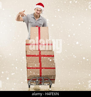 Courier, a handcart gift boxes - Stock Image