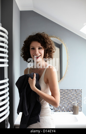 portrait of young woman in bathroom - Stock Image