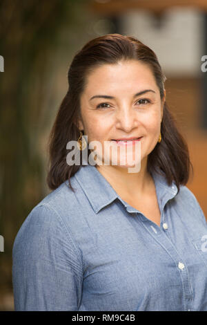 Happy confident Hispnaic woman smiling. - Stock Image