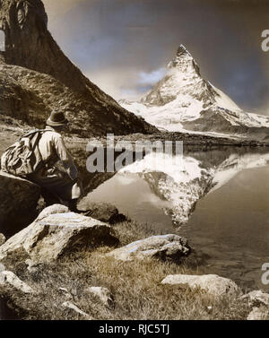 View of the distinctive peak of the Matterhorn from lake at foot of Riffelhorn, Zermatt, Switzerland - 21st August, 1939. - Stock Image