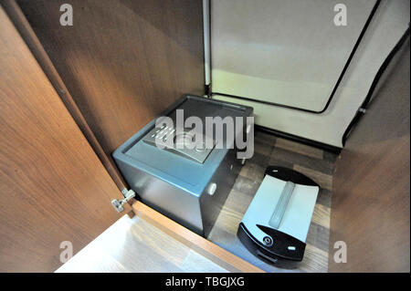 Two small built-in safes on the floor of a closet in a camper - Stock Image