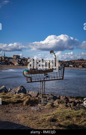 The Stonehaven Fishing Boat Sculpture along the beach front - Stock Image