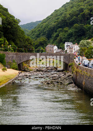 A39 Road bridge arches over the boulder strewn East Lyn river at Lynmouth, Devon, UK - Stock Image
