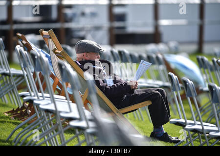 Hove Sussex, UK. 05th Apr, 2019. A spectator watches Sussex v Leicestershire in the Specasavers County Championship Division Two match at the 1st Central County Ground in Hove on a sunny but cool first morning of the season Credit: Simon Dack/Alamy Live News - Stock Image